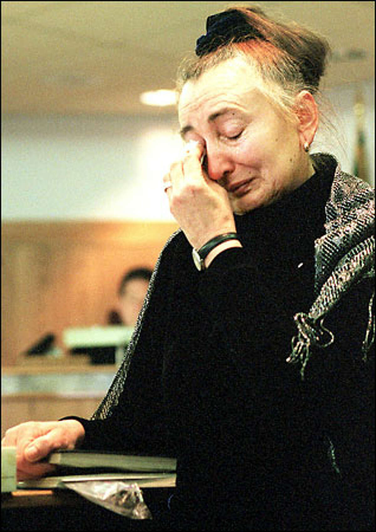 Alevtina Solovieva is overcome during the sentencing of King for the murder of her daughter.