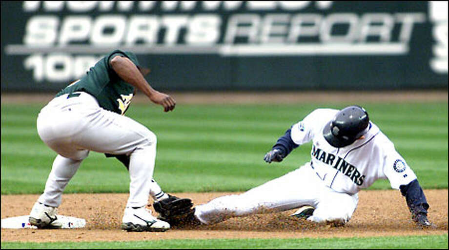 Ichiro is caught stealing by Oakland shortstop Miguel Tejada in the bottom of the third inning. Photo: Joshua Trujillo/Seattle Post-Intelligencer