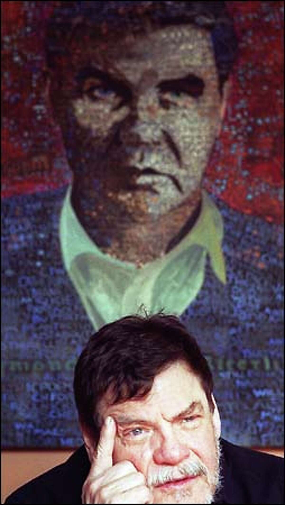 Mexico-born Seattle artist Alfredo Arreguin sits in front of his portrait of the late writer-poet -- and Arreguin soul mate -- Raymond Carver. Arreguin paints positive moods, shunning the negative, because then
