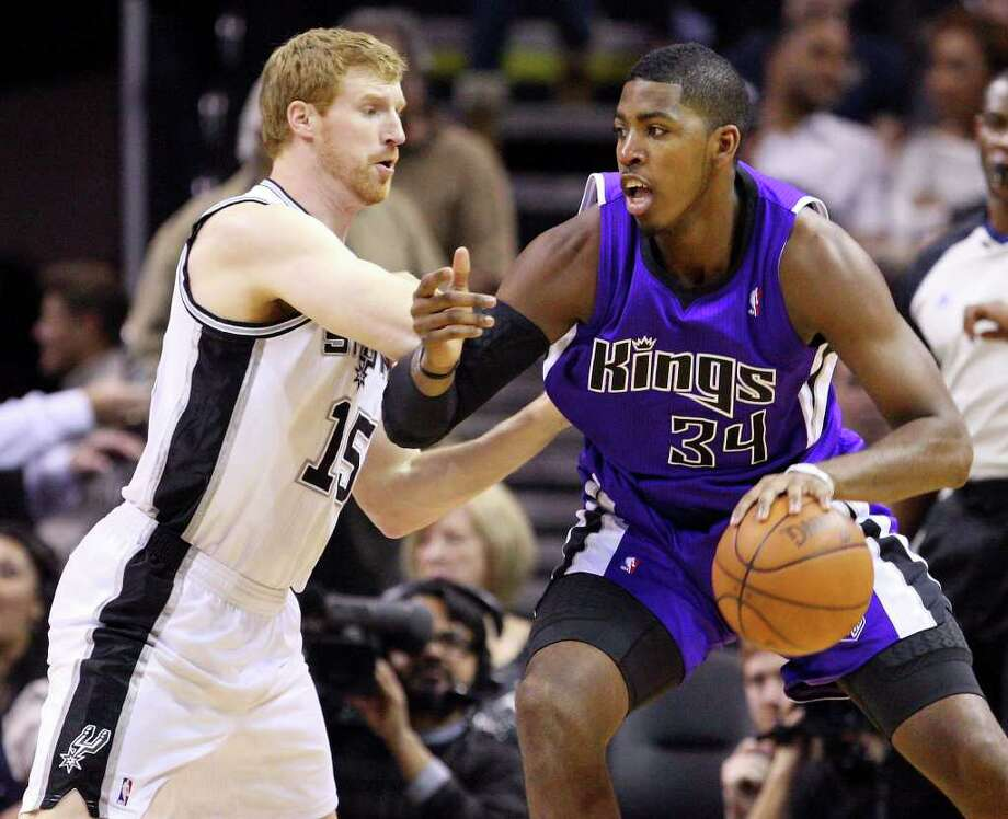 Spurs' Matt Bonner defends  Kings' Jason Thompson during first half action Friday March 11, 2011 at the AT&T Center.  (PHOTO BY EDWARD A. ORNELAS/eaornelas@express-news.net) Photo: EDWARD A. ORNELAS, SAN ANTONIO EXPRESS-NEWS / SAN ANTONIO EXPRESS-NEWS NFS