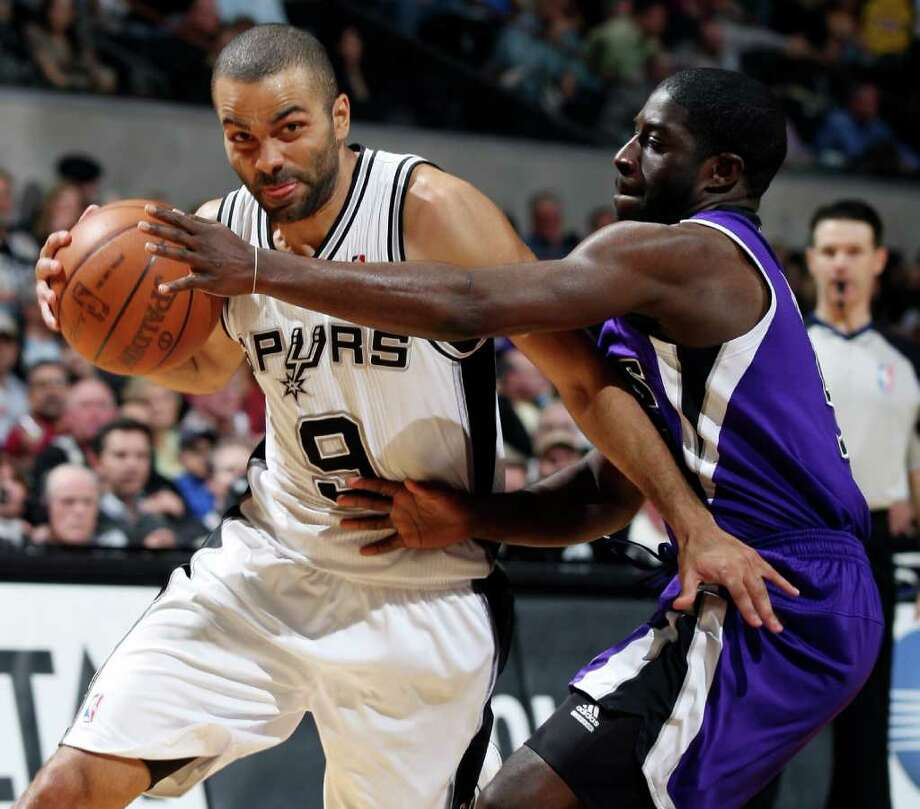 Spurs' Tony Parker drives around  Kings' Eugene Jeter during first half action Friday March 11, 2011 at the AT&T Center.  (PHOTO BY EDWARD A. ORNELAS/eaornelas@express-news.net) Photo: EDWARD A. ORNELAS, SAN ANTONIO EXPRESS-NEWS / SAN ANTONIO EXPRESS-NEWS NFS