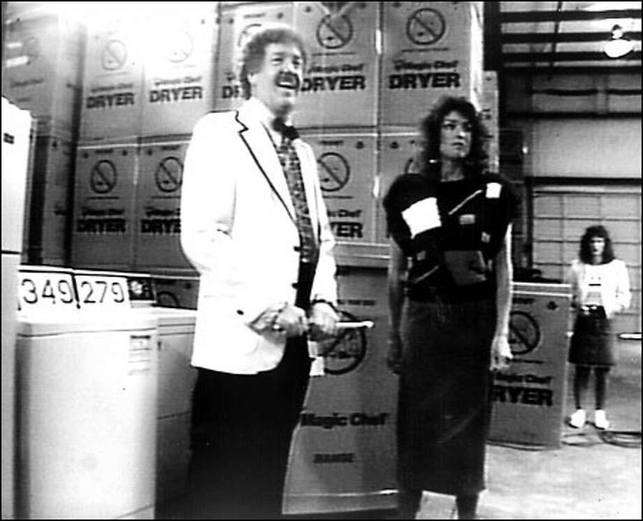 "Jack Roberts and wife Linda making one of their zany commercials in 1988. ""if you don't come into my store, you're paying too much!"" he would say. Photo: Seattle Post-Intelligencer File"