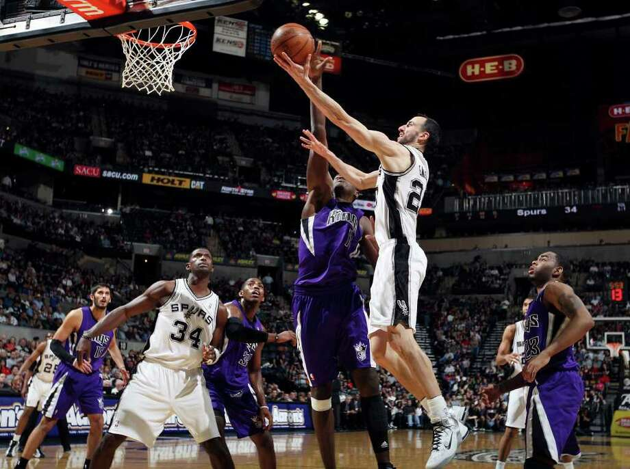 Spurs' Manu Ginobili shoots around  Kings' Samuel Dalembert during first half action Friday March 11, 2011 at the AT&T Center.  (PHOTO BY EDWARD A. ORNELAS/eaornelas@express-news.net) Photo: EDWARD A. ORNELAS, SAN ANTONIO EXPRESS-NEWS / SAN ANTONIO EXPRESS-NEWS NFS