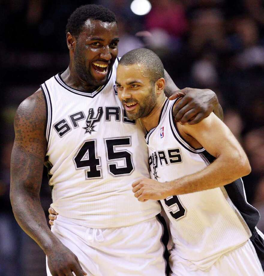 Spurs' DeJuan Blair hugs teammate Tony Parker after Parker scored a three pointer against the Kings during second half action Friday March 11, 2011 at the AT&T Center. The Spurs won 108-103.  (PHOTO BY EDWARD A. ORNELAS/eaornelas@express-news.net) Photo: EDWARD A. ORNELAS, SAN ANTONIO EXPRESS-NEWS / SAN ANTONIO EXPRESS-NEWS NFS