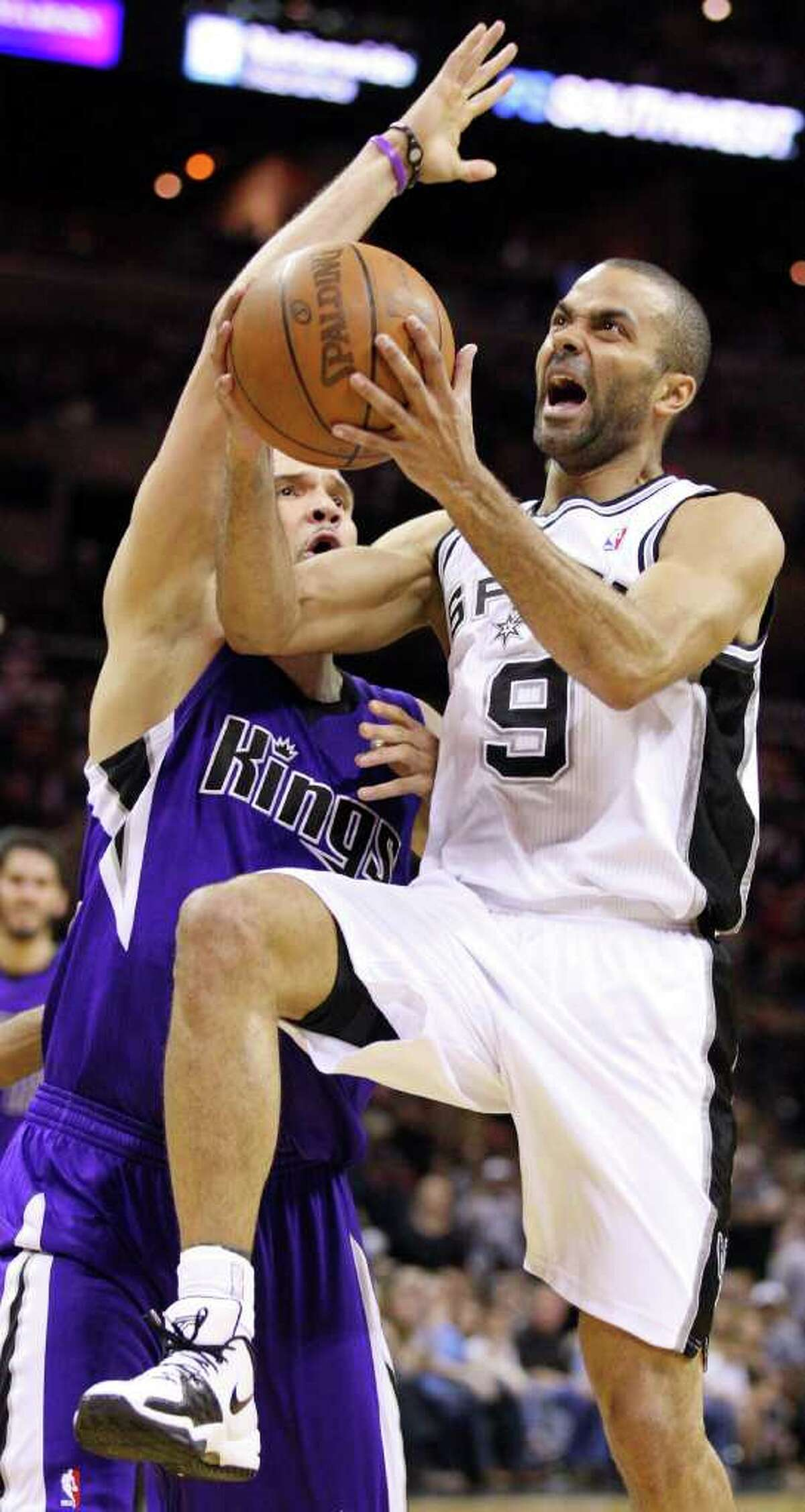 Spurs' Tony Parker drives to the basket around Kings' Francisco Garcia during second half action Friday March 11, 2011 at the AT&T Center. The Spurs won 108-103. (PHOTO BY EDWARD A. ORNELAS/eaornelas@express-news.net)