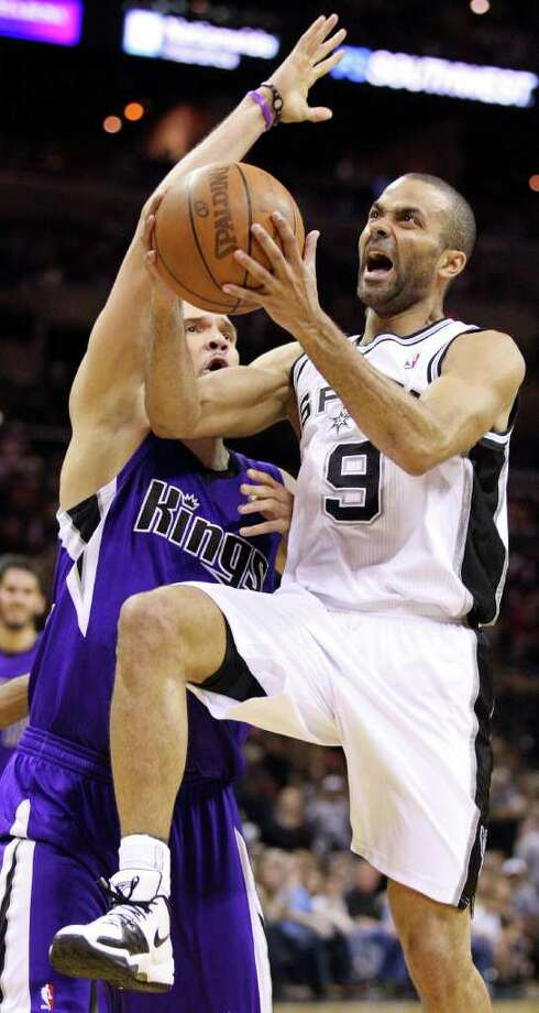 Spurs' Tony Parker drives to the basket around  Kings' Francisco Garcia during second half action Friday March 11, 2011 at the AT&T Center. The Spurs won 108-103.  (PHOTO BY EDWARD A. ORNELAS/eaornelas@express-news.net) Photo: EDWARD A. ORNELAS, SAN ANTONIO EXPRESS-NEWS / SAN ANTONIO EXPRESS-NEWS NFS