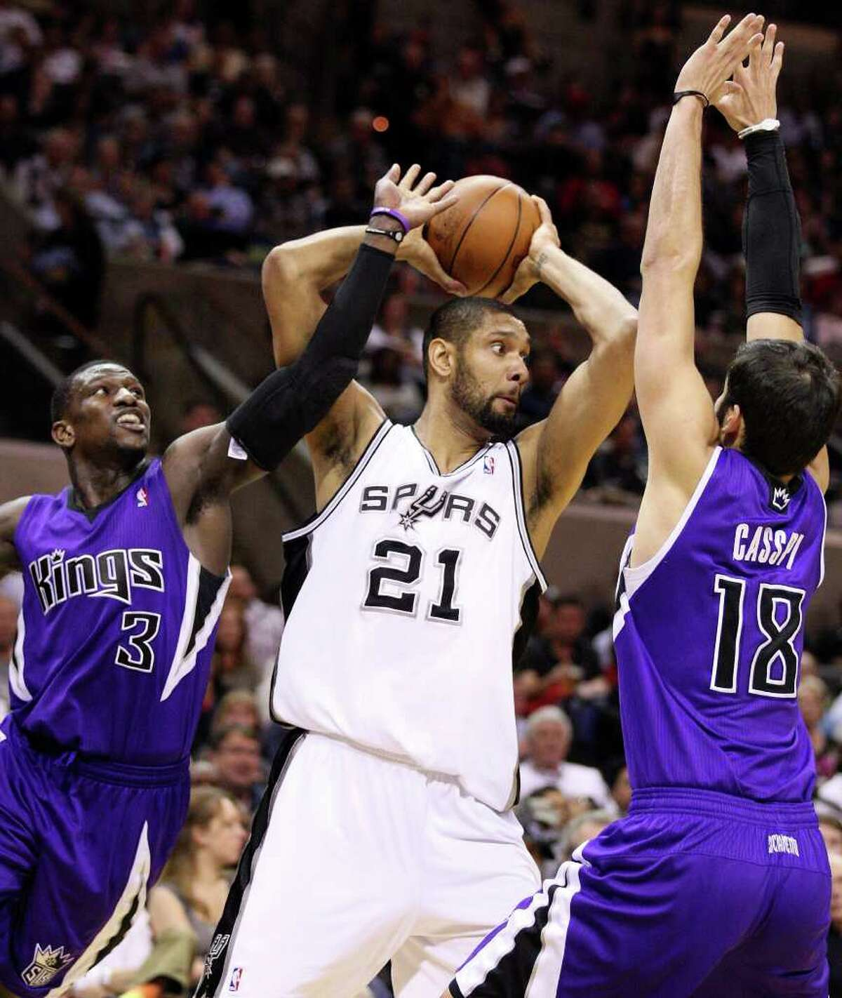 Spurs' Tim Duncan looks to pass between Kings' Jermaine Taylor and Kings' Omri Casspi during second half action Friday March 11, 2011 at the AT&T Center. The Spurs won 108-103. (PHOTO BY EDWARD A. ORNELAS/eaornelas@express-news.net)