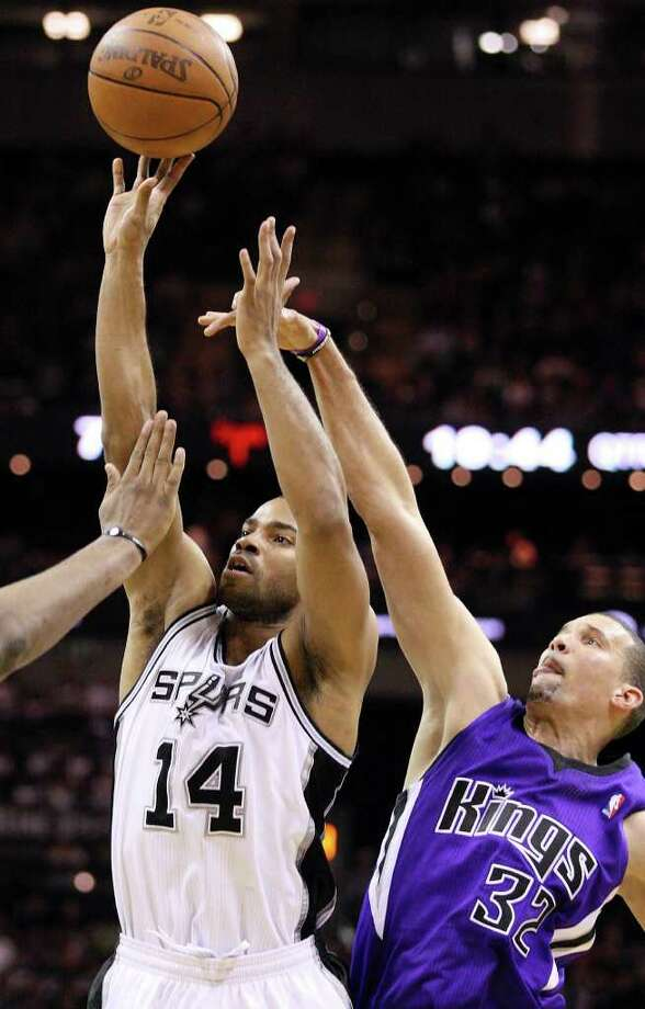 Spurs' Gary Neal shoots around  Kings' Francisco Garcia during second half action Friday March 11, 2011 at the AT&T Center. The Spurs won 108-103.  (PHOTO BY EDWARD A. ORNELAS/eaornelas@express-news.net) Photo: EDWARD A. ORNELAS, SAN ANTONIO EXPRESS-NEWS / SAN ANTONIO EXPRESS-NEWS NFS