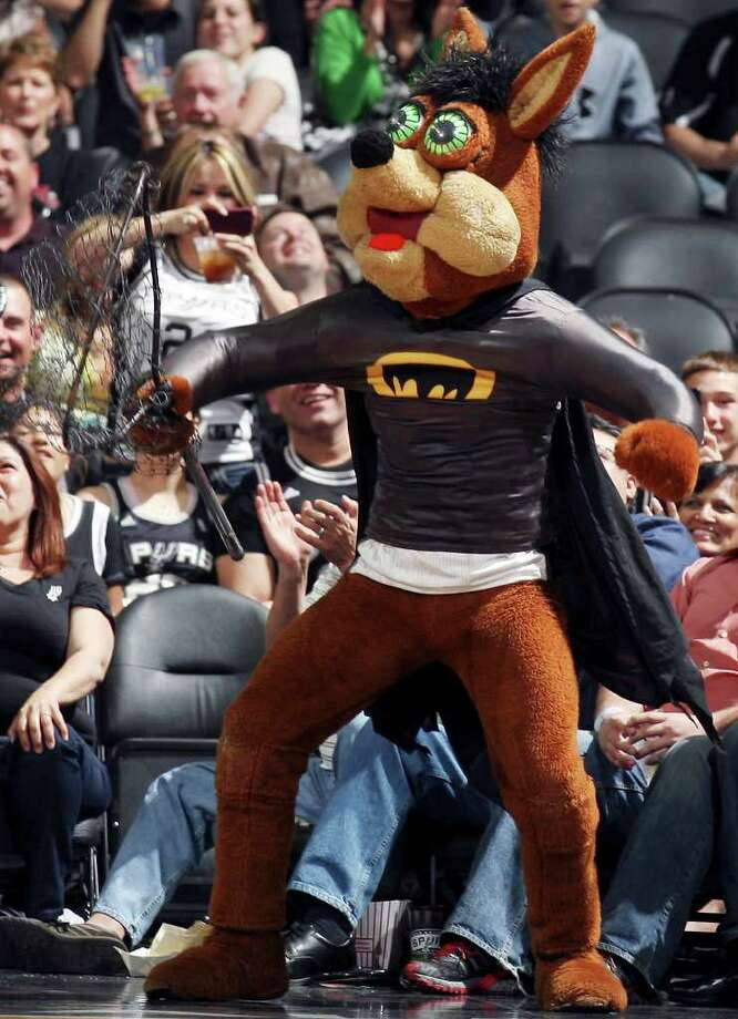 The  Spurs' Coyote wears a batman costume after a bat was taken off the court during first half action of the game with the Kings Friday March 11, 2011 at the AT&T Center.  (PHOTO BY EDWARD A. ORNELAS/eaornelas@express-news.net) Photo: EDWARD A. ORNELAS, SAN ANTONIO EXPRESS-NEWS / SAN ANTONIO EXPRESS-NEWS NFS