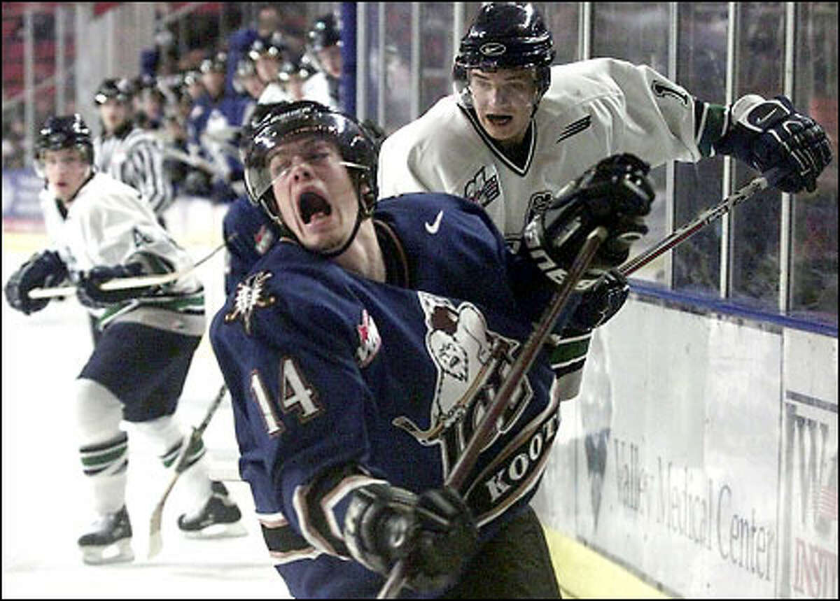 Kootenay's Adam Taylor reacts to a check by the T-Birds' Ryan Gibbons. The Ice outscored Seattle 20-7 in the series.