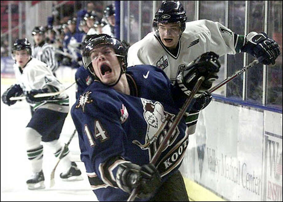 Kootenay's Adam Taylor reacts to a check by the T-Birds' Ryan Gibbons. The Ice outscored Seattle 20-7 in the series. Photo: Paul Kitagaki Jr./Seattle Post-Intelligencer
