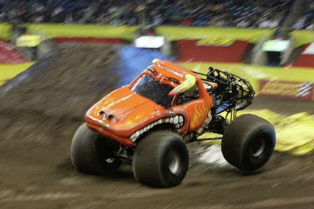 Fans at Monster Jam at the Webster Bank Arena in Bridgeport cheered on drivers of the premier monster truck series on March 11, 2011. Photo: Peter Caty, Peter Caty/Hearst Media Group / Connecticut Post