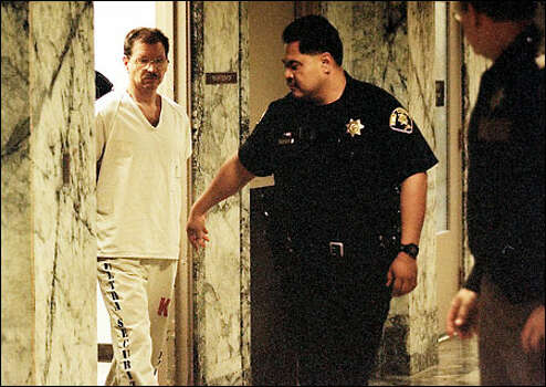 Guards lead Gary Ridgway toward the courtroom of Judge Richard Jones. Photo: Dan DeLong/Seattle Post-Intelligencer
