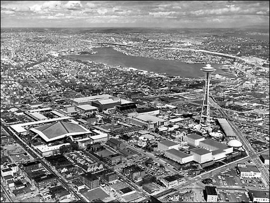 The Space Needle soars high above the World's Fair site, which eventually became the Seattle Center. Photo: P-I File/1962