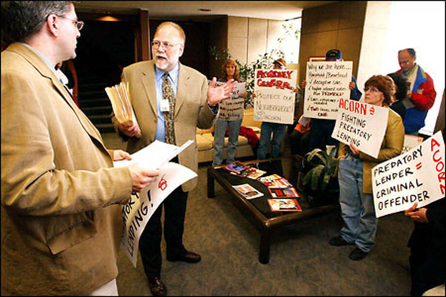 Assistant Attorney General Dave Huey, second from left, meets with members of a group protesting the mortgage lending practices of HFC. Photo: Mike Urban/Seattle Post-Intelligencer