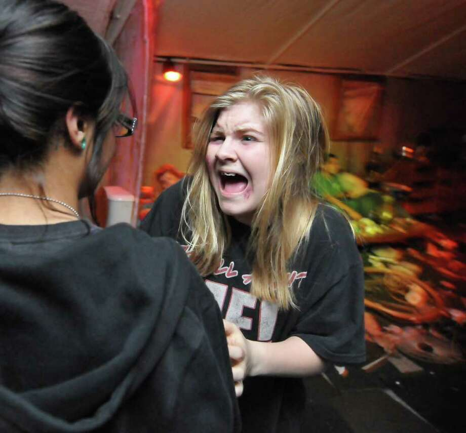 Actress Ashley McCrutcheon turns and screams at the audience during a scene about a desperate addict in a crack house. Photo: Robin Jerstad, Robin Jerstad/Special To The Express-News / Copyright 2011 by Robin Jerstad, Jerstad Photographics LLC-www.JerstadPhoto.com