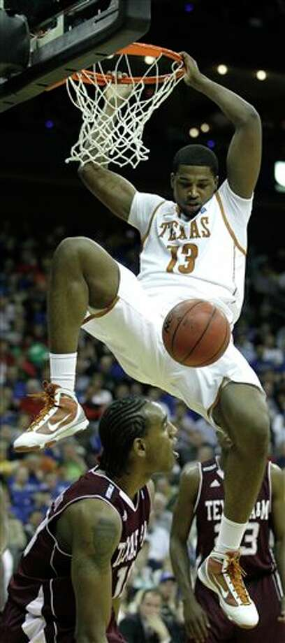 Texas' Tristan Thompson, who had 14 points and 13 rebounds, dunks on Texas A&M's David Loubeau in the first half. CHARLIE RIEDEL/ASSOCIATED PRESS