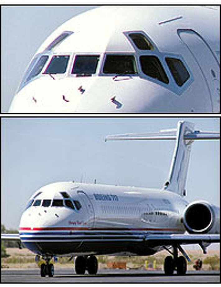 "This photo of a Boeing 717 shows the so-called ""eyebrow"" windows that are scheduled to be elimi- nated as a cost-saving measure."