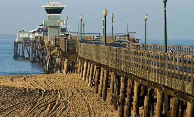 The shore and pier at Seal Beach, Calif. are closed to the public as officials wait for a tsunami warning to pass on Friday, March 11, 2011, after a major earthquake and tsunami struck Japan. (AP Photo/Orange County Register, Bruce Chambers) Photo: Bruce Chambers
