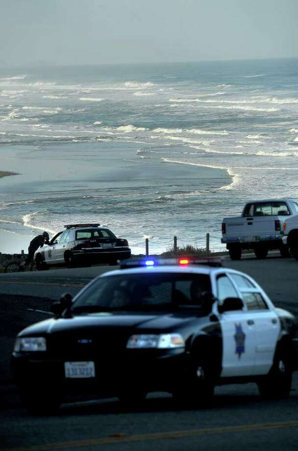 With a tsunami warning in effect for Northern California, police patrol along San Francisco's Great Highway on Friday, March 11, 2011. Tsunami warnings were issued after an 8.9-magnitude earthquake struck Japan. (AP Photo/Noah Berger) Photo: Noah Berger
