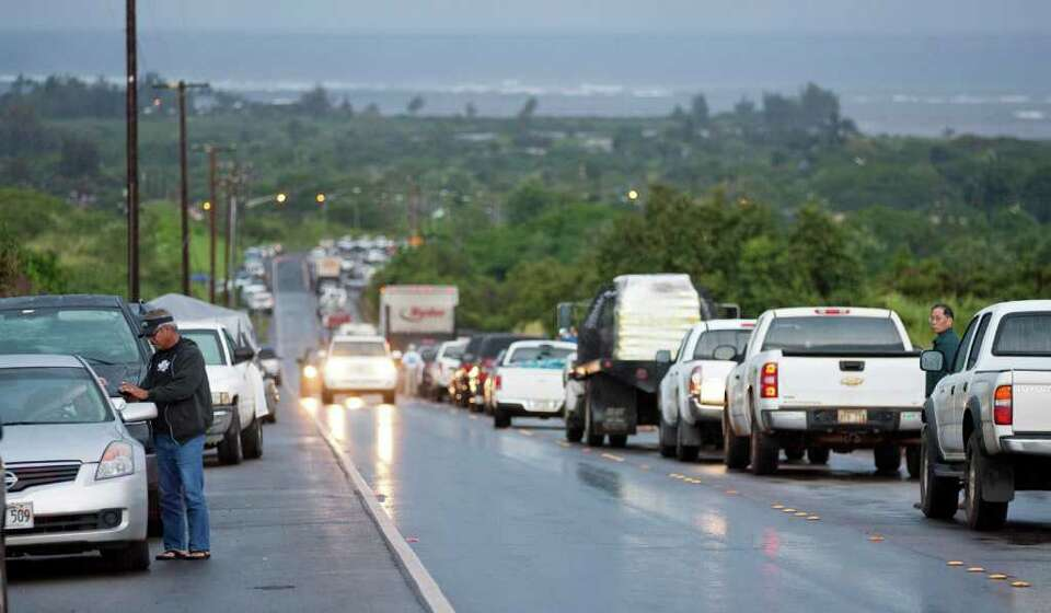 Due to a tsunami warning hundreds of cars line Kamehameha Highway leading into the town of Haleiwa a