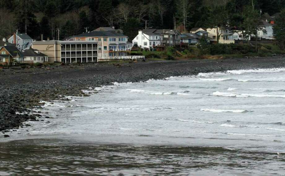 Ocean waters from a tsunami surge hit the rocky coast in Seaside, Ore., Friday, March, 11, 2011.  The tsunami traveled across the Pacific Ocean after an 8.9-magnitude earthquake struck the east coast of Japan. (AP Photo/Don Ryan)(AP Photo/Don Ryan) Photo: Don Ryan
