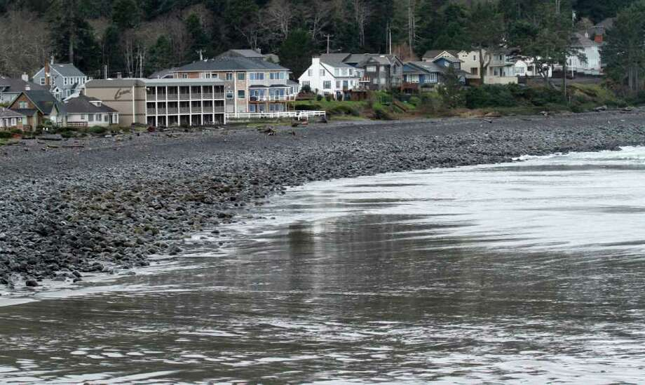 Bare beach is shown as the water recedes before a tsunami surge in Seaside, Ore., Friday, March, 11, 2011. The tsunami traveled across the Pacific Ocean after an 8.9-magnitude earthquake struck the east coast of Japan. (AP Photo/Don Ryan) Photo: Don Ryan