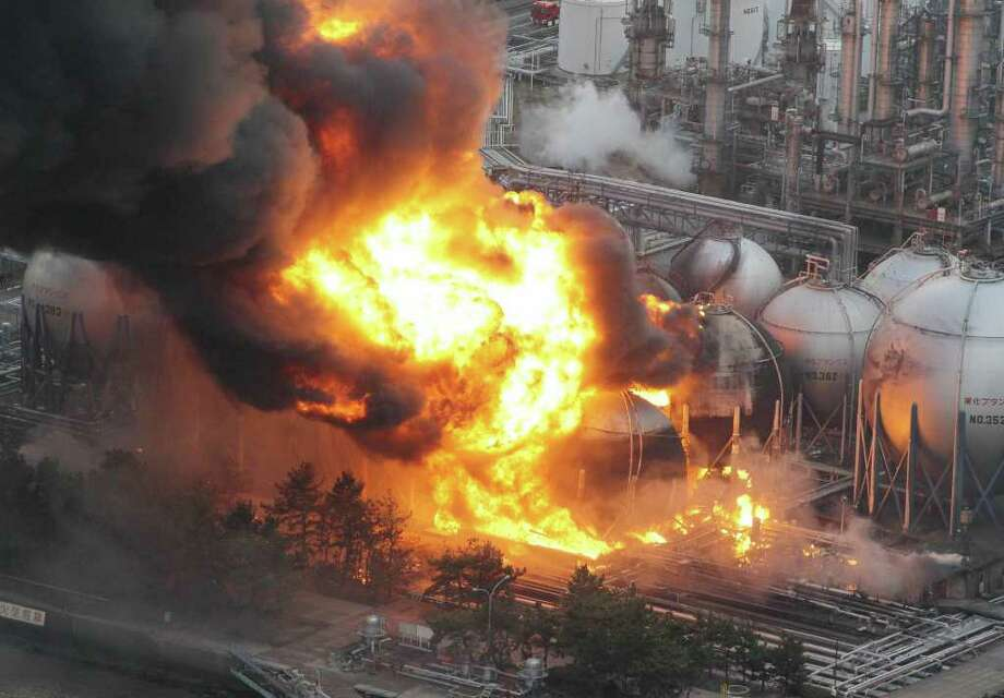 Giant fireballs rise from a burning oil refinery in Ichihara, Chiba Prefecture (state) after Japan was struck by a strong earthquake off its northeastern coast Friday, March 11, 2011. (AP Photo/Kyodo News) JAPAN OUT, MANDATORY CREDIT, FOR COMMERCIAL USE ONLY IN NORTH AMERICA