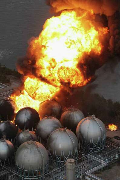 Giant fireballs rise from a burning oil refinery in Ichihara, Chiba Prefecture (state) after Japan w