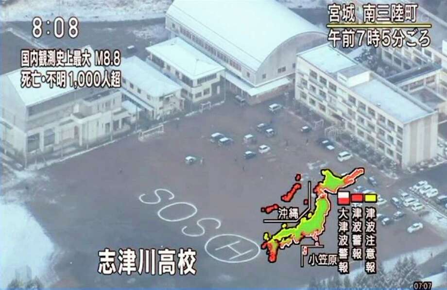 In this image made from Japan's NHK television, an SOS sign is seen on the ground of Shizugawa High School in Minamisanriku, Miyagi, northern Japan, Saturday morning, March 12, 2011, after Japan's biggest recorded earthquake slammed into its eastern coasts Friday. (AP Photo/NHK TV) MANDATORY CREDIT, JAPAN OUT, NO SALES, TV OUT, EDITORIAL USE ONLY