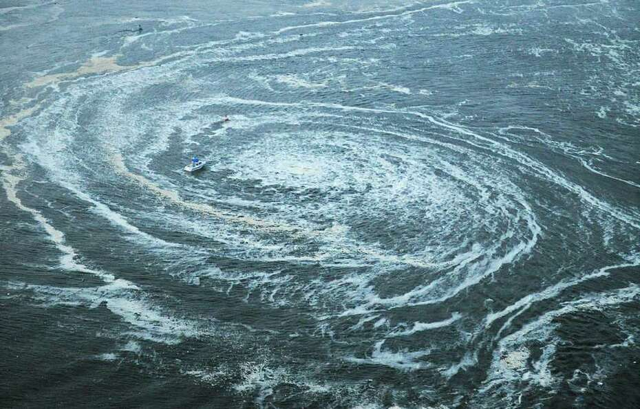 Tsunami swirls near a port in Oarai, Ibaraki Prefecture (state) after Japan was struck by a strong e