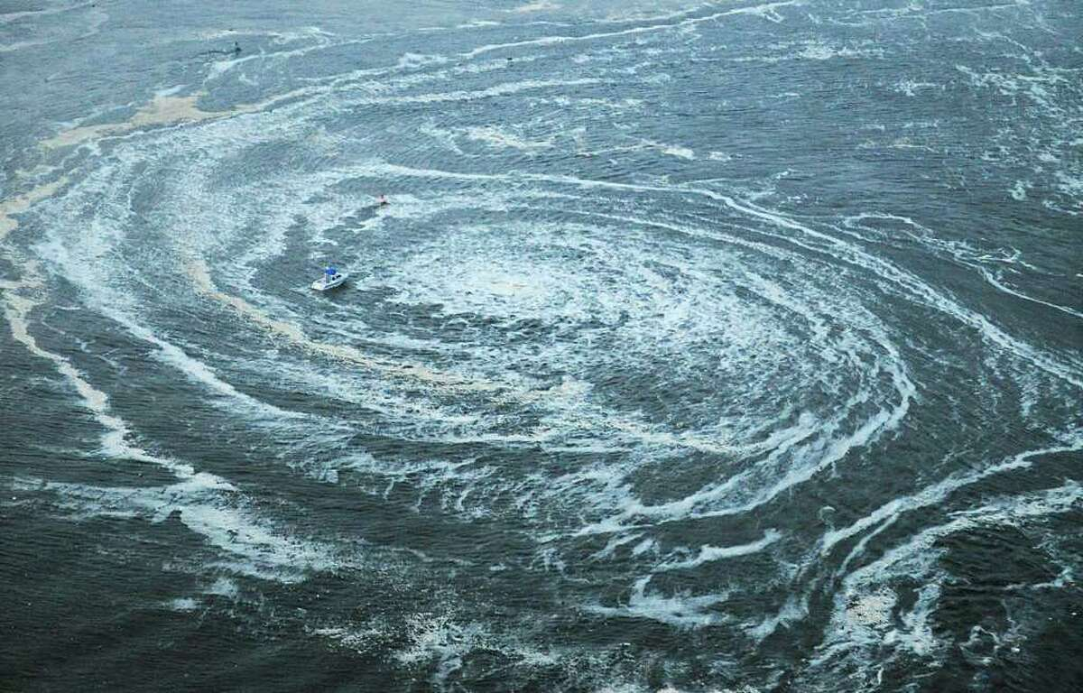 Tsunami swirls near a port in Oarai, Ibaraki Prefecture (state) after Japan was struck by a strong earthquake off its northeastern coast Friday, March 11, 2011. (AP Photo/Kyodo News) JAPAN OUT, MANDATORY CREDIT, FOR COMMERCIAL USE ONLY IN NORTH AMERICA