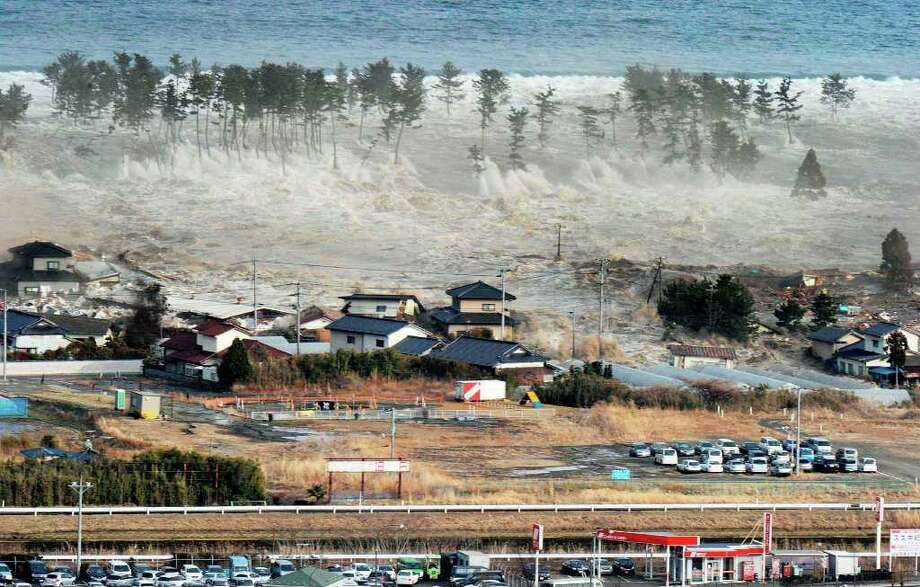 Waves of tsunami hit residences after a powerful earthquake in Natori, Miyagi prefecture (state), Japan, Friday, March 11, 2011.  The largest earthquake in Japan's recorded history slammed the eastern coast Friday. (AP Photo/Kyodo News) MANDATORY CREDIT, NO LICENSING ALLOWED IN CHINA, HONG KONG, JAPAN, SOUTH KOREA AND FRANCE