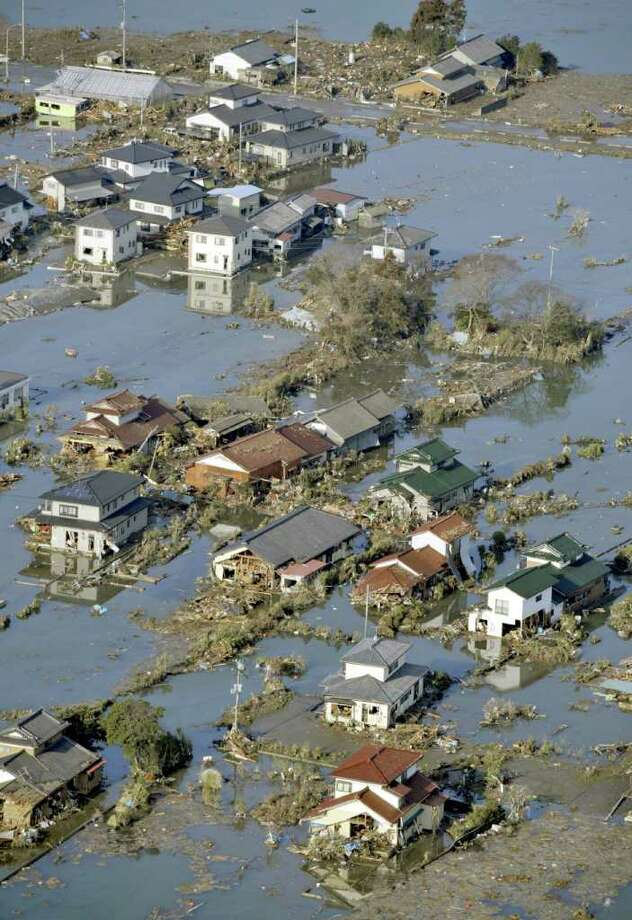 A residential area is flooded in Watari-cho, Miyagi, northern Japan Saturday, March 12, 2011 after Japan's biggest recorded earthquake slammed into its eastern coast Friday. (AP Photo/Kyodo News)  MANDATORY CREDIT, NO LICENSING ALLOWED IN CHINA, HONG  KONG, JAPAN, SOUTH KOREA AND FRANCE