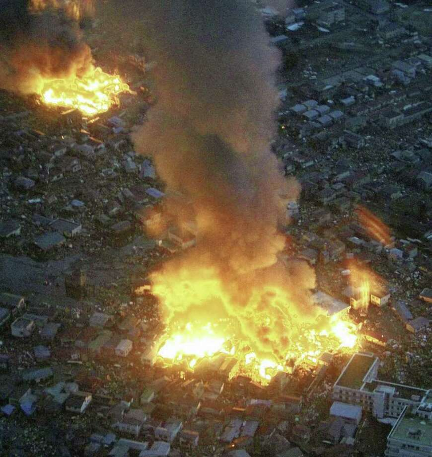 RETRANSMISSION WITH BETTER QUALITY - Buildings burn in Yamada town, Iwate prefecture (state) after Japan's biggest recorded earthquake hit  Friday March 11, 2011. (AP Photo/The Yomiuri Shimbun) JAPAN OUT, CREDIT MANDATORY