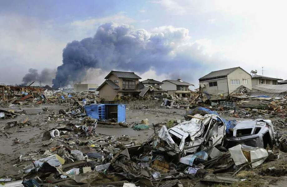 Damaged vehicles are left in Sendai, northern Japan Saturday, March 12, 2011 after Japan's biggest recorded earthquake slammed into its eastern coast Friday. (AP Photo/Kyodo News)  MANDATORY CREDIT, NO LICENSING ALLOWED IN CHINA, HONG  KONG, JAPAN, SOUTH KOREA AND FRANCE