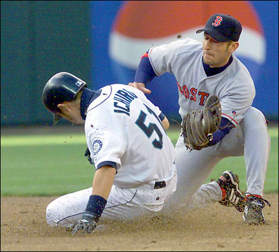 Ichiro beats Nomar Garciaparra's tag on a third-inning stolen base. Ichiro later scored to give the M's their first lead -- ever -- against Pedro Martinez. Photo: Grant M. Haller/Seattle Post-Intelligencer