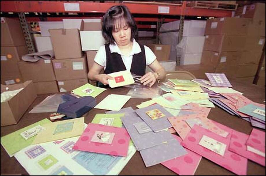 For one company helping competitors was in the cards seattlepi yuk ho kwong puts the finishing touches on greeting cards at madison park greetings in seattle m4hsunfo