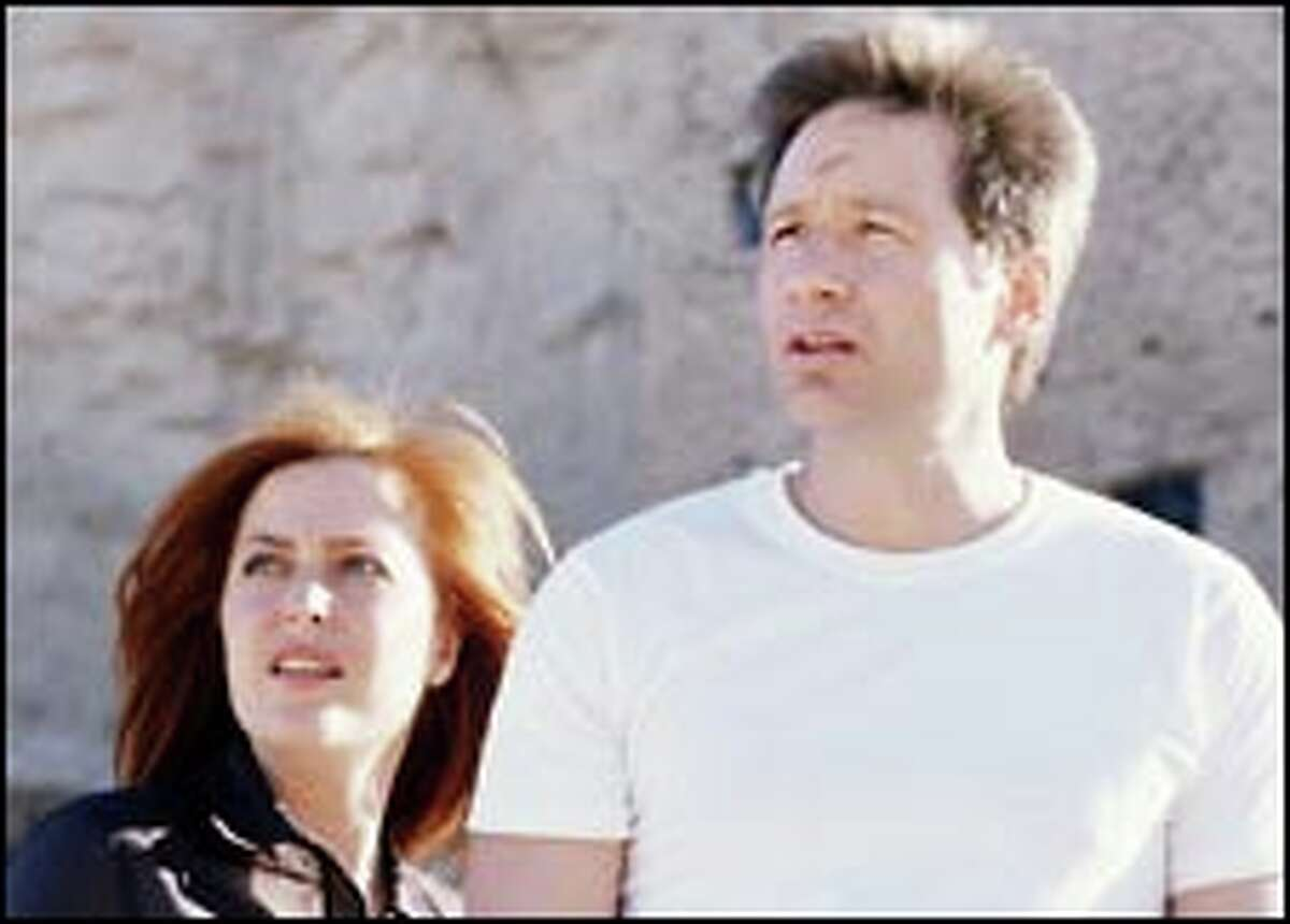 """Breaking up is hard to do with this kind of intellectual chemistry. FBI agents Dana Scully (Gillian Anderson) and Fox Mulder (David Duchovny), above, will share the screen one last time Sunday for the final """"X-Files"""" episode."""