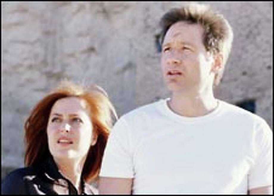 """Breaking up is hard to do with this kind of intellectual chemistry. FBI agents Dana Scully (Gillian Anderson) and Fox Mulder (David Duchovny), above, will share the screen one last time Sunday for the final """"X-Files"""" episode. Photo: FOX TV"""