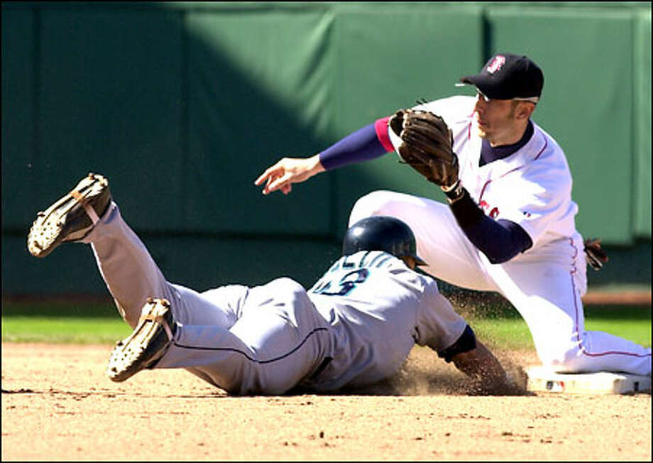 Red Sox shortstop Nomar Garciaparra waits to apply the tag to Luis Ugueto, caught trying to steal for the final out in Boston's 3-2 victory. Photo: / Associated Press