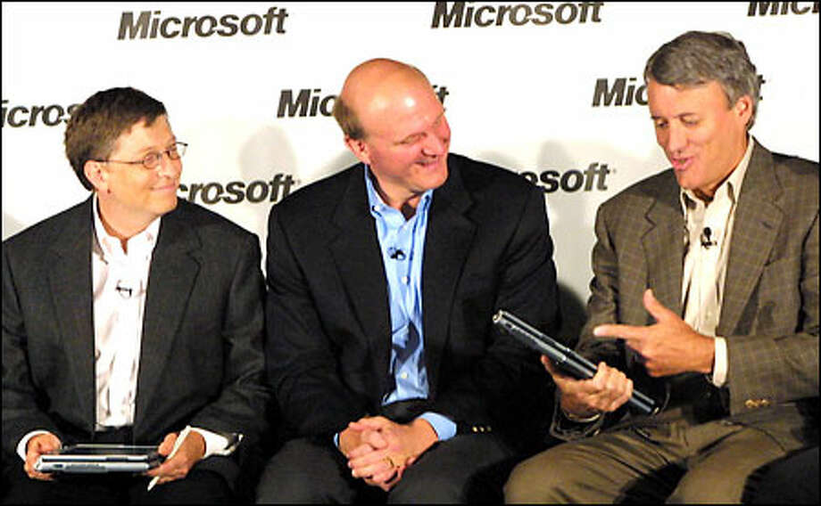 John Eyler, right, chief executive of Toys R Us, talks about the new Tablet PC with, Microsoft Chairman Bill Gates, left, and Chief Executive Steve Ballmer. Photo: Associated Press