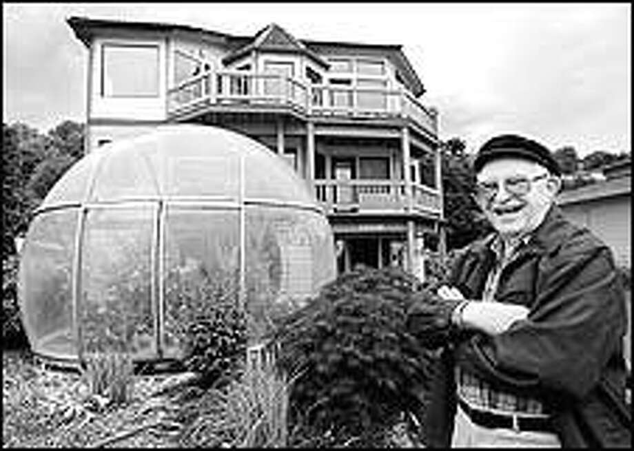 """Charlie Kessner of Burien was reunited with the Bubbleator that he helped build for the World's Fair in Seattle in 1962. """"Who would have believed I'd be standing in front of it 40 years later,"""" said Kessner with a laugh. Photo: Renee C. Byer/P-I"""