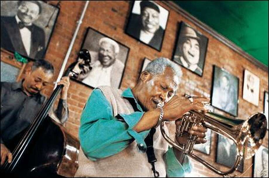 Floyd Standifer has been playing jazz at the New Orleans Restaurant for 16 years. Here he is playing the flugelhorn, but he also plays trumpet and saxophone, and sings. Photo: Meryl Schenker/Seattle Post-Intelligencer
