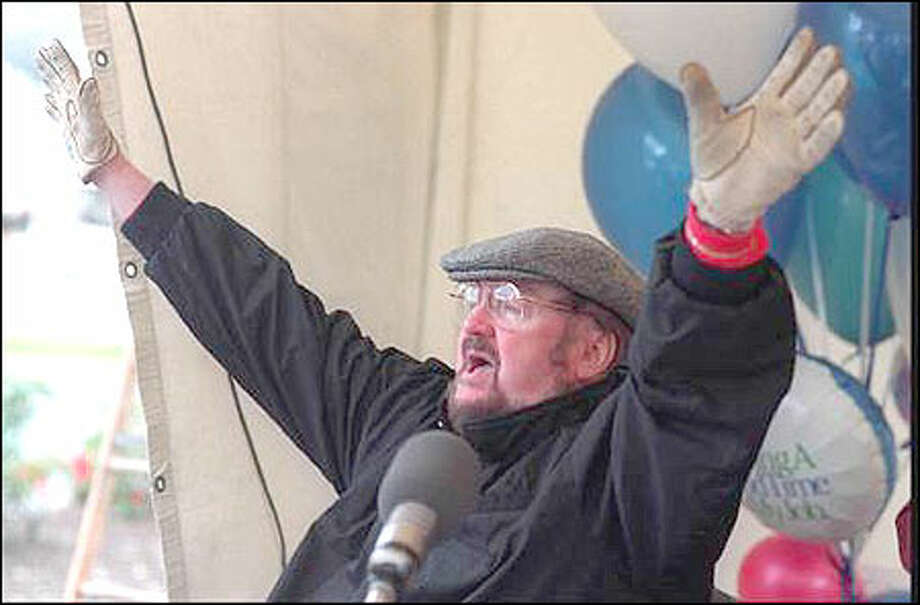 Seattle sportcaster  icon Wayne Cody of KIRO Radio waves goodbye for the final time on his last  radio broadcast for KIRO after 21 years. His final braodcast was outside Duke's   Restaurant on Lake Union. P-I File Photo Photo: / Seattle Post-Intelligencer
