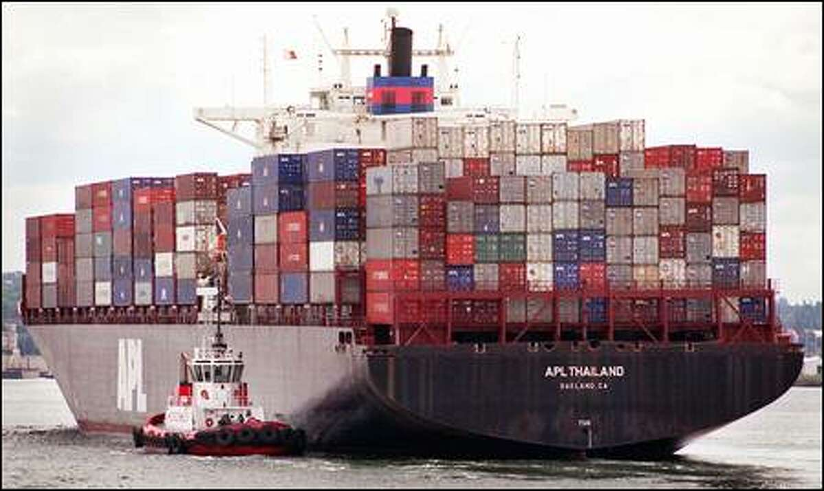 A container ship arrives in the Port of Seattle recently, ready to be unloaded. In 2001, about 1.3 million containers were shipped through the port.
