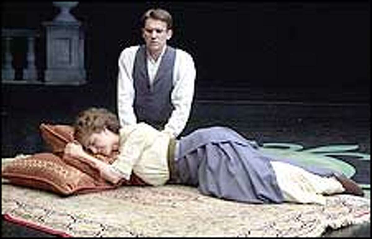 """In Book-It's """"Howards End"""" 14 actors play 18 roles. Above, Emily Grogan and Jonah Von Spreecken play Helen and Tibby Schlegel."""