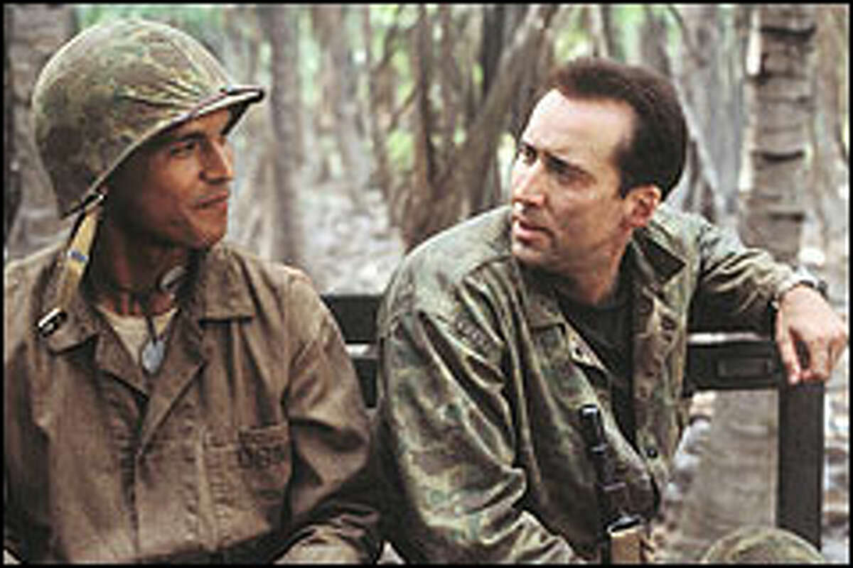 """Nicolas Cage, right plays a Marine corporal charged with protecting a Navajo """"code talker"""" (Adam Beach) during the WWII battle of Saipan. Code talkers were used to send communications in Navajo -- foiling Japanese eavesdroppers."""