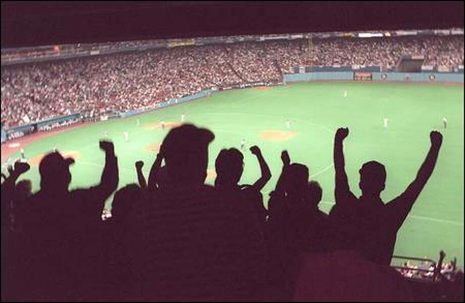 Mariners fans rocked the Kingdome during the team's '95 playoff run. The most expensive ticket that season was $15. Photo: / Seattle Post-Intelligencer