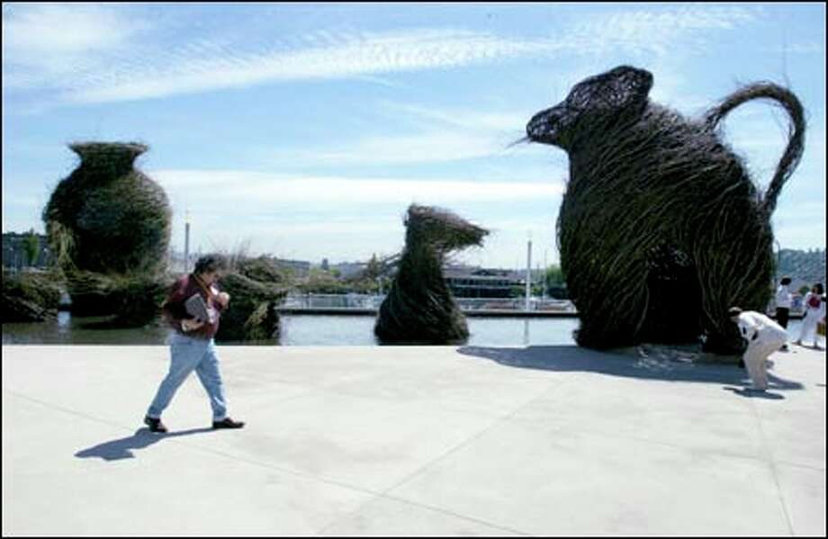 """Call of the Wild 2002,"" by Patrick Dougherty, is one of the outside installations at the museum. Photo: Gilbert W. Arias/Seattle Post-Intelligencer"